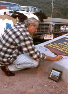 Artie Kornfeld signing the Woodstock Monument